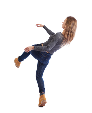 Balancing young woman.  or dodge falling woman. Rear view people collection.  backside view of person.  Isolated over white background. A young girl in a striped sweater slipping down onto her back.