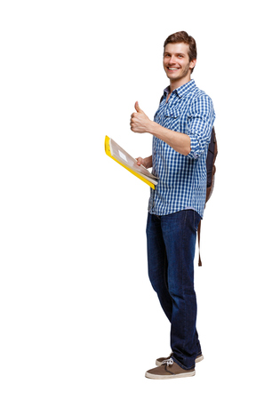 Side view of student man showing thumb up. Rear view people collection. backside view of person.  Isolated over white background.