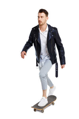 Front view of a man with a skateboard. Rear view people collection. backside view of person.  Isolated over white background. Stockfoto