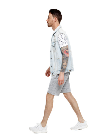 Back view of going  handsome man in a shorts. walking young guy . Rear view people collection.  backside view of person. Isolated over white background.