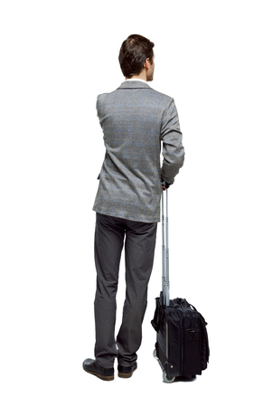Back view of business man with suitcase talking on the phone. Standing young girl. Rear view people collection.  backside view of person. Isolated over white background. The man is looking sideways thoughtfully.