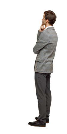 Back view of Business man looks.  Rear view people collection.  backside view of person. Isolated over white background. The man thoughtfully looks ahead.
