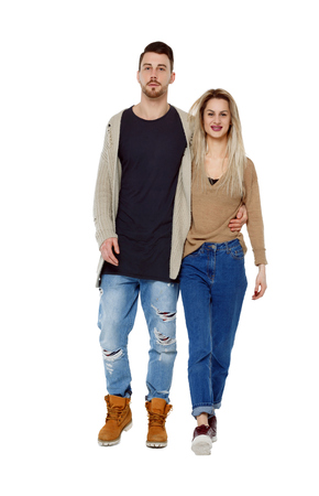 Front view of going couple. walking friendly girl and guy holding hands. Front view people collection. Isolated over white background. Young people walking together.