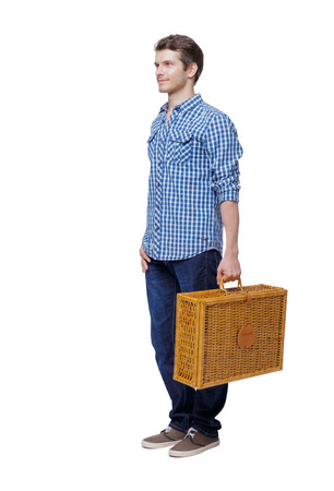 Back view of a man walking with a picnic bag. backside view of person.  Rear view people collection. Isolated over white background. Stylish guy in the shirt is looking forward.