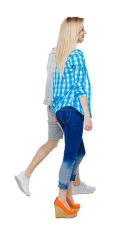 Side view of going couple. walking friendly girl and guy holding hands. Rear view people collection. backside view of person. Isolated over white background. The guy and the girl go hand in hand.