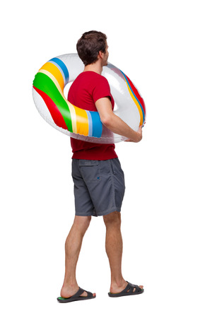 Side view of man with a beach bag that goes to side. backside view of person. Rear view people collection. Isolated over white background. The guy goes swimming at the beach.