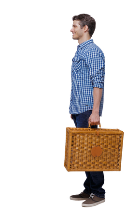 Side view of a man walking with a picnic bag. backside view of person. Rear view people collection. Isolated over white background. Stylish guy in shirt is smiling.