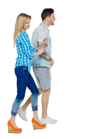 Side view of going couple. walking friendly girl and guy holding hands. Rear view people collection. backside view of person. Isolated over white background. The girl goes taking her boyfriend's hand.