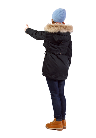 Side view of woman in parka thumbs up. Rear view people collection. backside view of person. Isolated over white background.