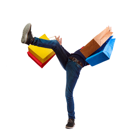 Falling man with shopping bags. Guy in motion.  backside view of person.  Rear view people collection. Isolated over white background. A man with purchases slipping down onto his back.