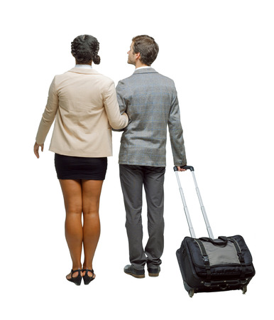 Back view of interracial couple with suitcase. Rear view people collection. backside view of person. Isolated over white background. Businessmen in a business trip