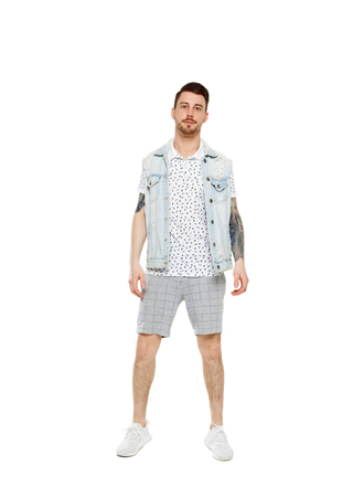 Front view of a stylish man iin shorts. Rear view people collection.  backside view of person.  Isolated over white background. Stylish bearded guy posing. Imagens