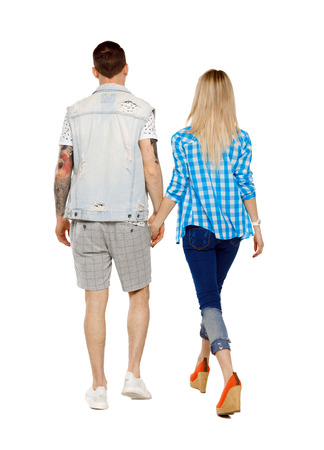 Back view of going couple. walking friendly girl and guy holding hands. Rear view people collection. backside view of person. Isolated over white background. Stylish couple holding hands Imagens