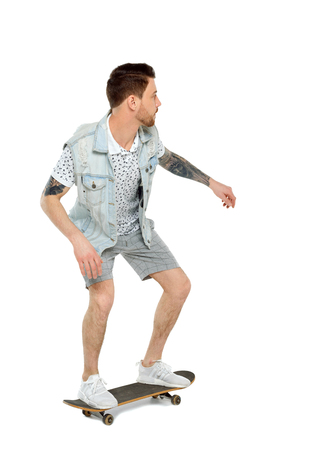 Back view of a man with a skateboard. Rear view people collection.  backside view of person.  Isolated over white background. Tattooed skater rides.