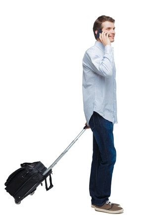 Side view of walking business man with suitcase talking on the phone. Standing young girl. Rear view people collection.  backside view of person. Isolated over white background. A young businessman happily talking on the phone. Imagens