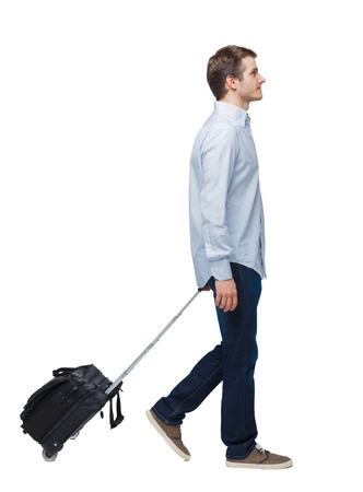 Side view of walking business man with suitcase talking on the phone. Standing young girl. Rear view people collection.  backside view of person. Isolated over white background. Young businessman with a suitcase passes by. Imagens