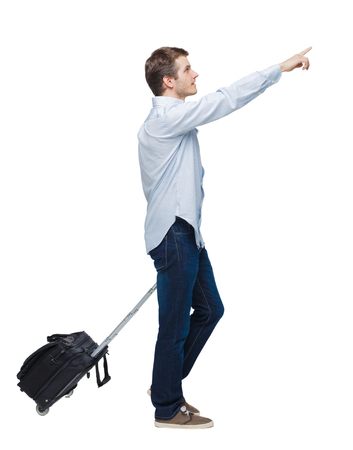 Side view of walking business man with suitcase talking on the phone. Standing young girl. Rear view people collection.  backside view of person. Isolated over white background. Young businessman with a suitcase passes by a hand pointing.