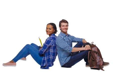 Side view of a couple of students who are sitting on the floor with their backs. Isolated over white background. Students sit on the grass with their backs pressed.