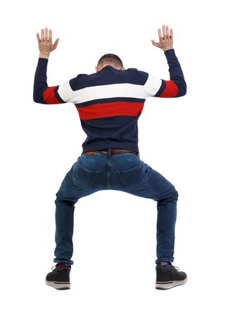 back view. man  protects hands from what is falling from above. Man holding a heavy load Rear view people collection. backside view of person.  Isolated over white background. The guy in the striped sweater holds a heavy load over his head.