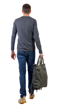 back view of walking  man  with green bag. backside view of person.  Rear view people collection. Isolated over white background. The guy in the gray sweater holds a big bag in his hand.