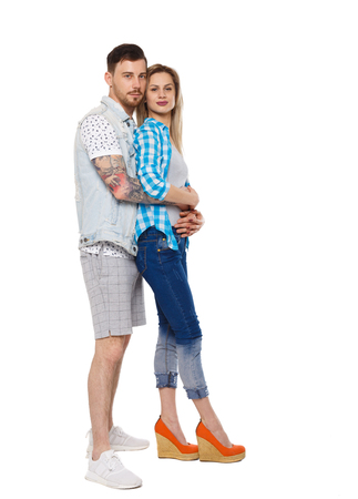 Side view of a stylish couple. beautiful friendly girl and guy together. Front view people collection.  backside view of person.  Isolated over white background. Stylish couple in summer clothes hugging.