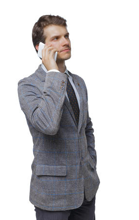 back view of business man in suit talking on mobile phone. fromt view people collection. Isolated over white background. Pensive businessman talking on a smartphone.