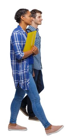Side view of interracial going couple. walking friendly girl and guy holding hands. Rear view people collection. backside view of person. Isolated over white background. Young students walk past smiling.