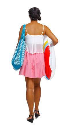 Back view of an African-American with a beach bag that goes to the side. backside view of person. Rear view people collection. Isolated over white background.