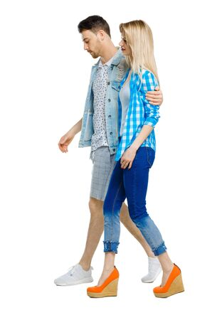 Side view of going couple. walking friendly girl and guy holding hands. Rear view people collection. backside view of person. Isolated over white background.