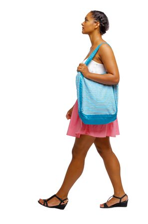 Side view of an African-American with a beach bag that goes to the side. backside view of person. Rear view people collection. Isolated over white background. Stock Photo