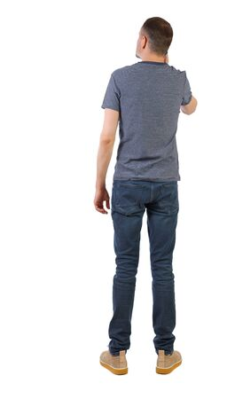 back view of a man talking on the phone. backside view of person. The guy in the shoes looks up thoughtfully. Rear view people collection. Isolated over white background.