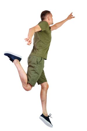 Back view of pointing man in zero gravity or a fall. guy is flying, falling or floating in the air. Side view people collection. side view of person. Isolated over white background. The guy in shorts and sneakers in a jump is trying to reach for something.