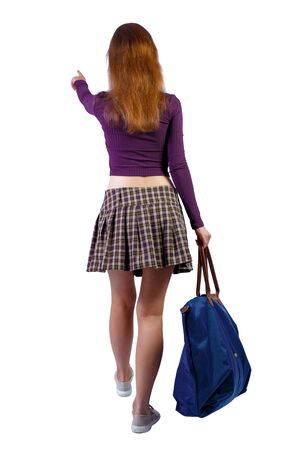 back view of walking woman with blue bag. backside view of person.  Rear view people collection. Isolated over white background. Red-haired girl with a big blue bag in their hands on the go shows the target.