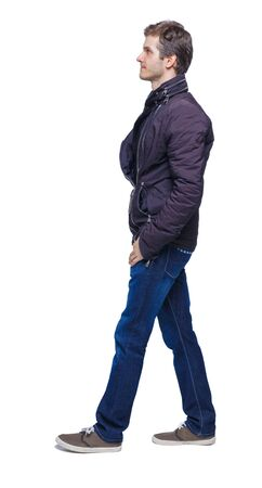 Side view of going handsome man in jeans and jacket. walking young guy . Rear view people collection. backside view of person. Isolated over white background.