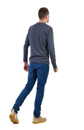 Back view of going handsome man . walking young guy . Rear view people collection. Isolated over white background.