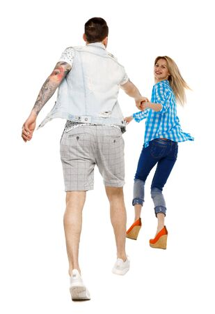 Back view of going couple. walking friendly girl and guy holding hands. backside view of person. Isolated over white background.
