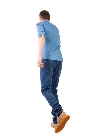 back view of running man. backside view of person. Rear view people collection. Isolated over white background. The guy in the shirt jumps forward. 写真素材