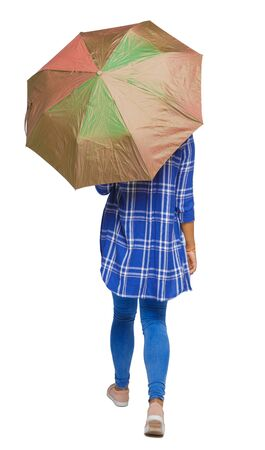back view of a dark-skinned girl in a shirt walking under an umbrella. backside view of person. Rear view people collection. Isolated over white background. Black teen girl goes under the umbrella.