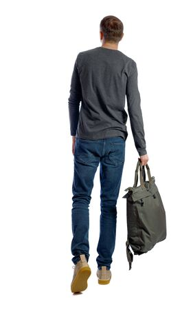 back view of walking man with green bag. backside view of person. Rear view people collection. Isolated over white background. 写真素材