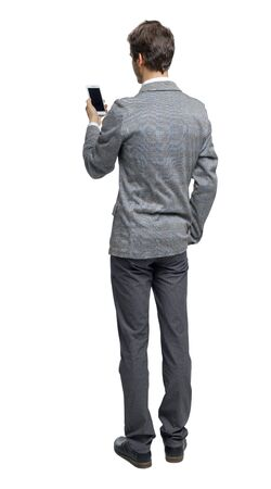 Back view of a businessman who is looking into the smartphone. rear view people collection. Isolated over white background. backside view of person.