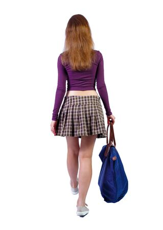 back view of walking woman with blue bag. Isolated over white background.