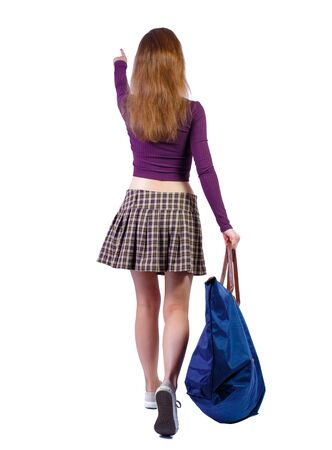 back view of walking woman with blue bag. backside view of person. Rear view people collection. Isolated over white background. Red-haired girl with a big blue bag in their hands on the go shows the t