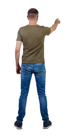 Back view of a man in jeans points his hand upwards. Rear view people collection.  backside view of person.  Isolated over white background.
