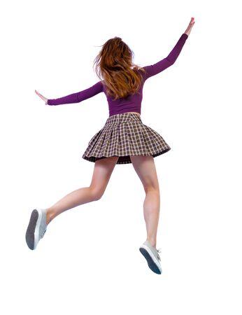 Vista posterior de la niña en un salto. Saltos de niña pelirroja. vista lateral posterior de la persona. Aislado sobre fondo blanco.