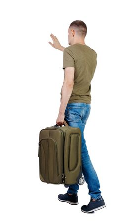 back view of walking man with suitcase greeting. brunette guy in motion. backside view of person. Rear view people collection. Isolated over white background.