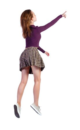 Side view of running pointing woman in dress. beautiful redhead girl in motion. back side view of person. Rear view people collection. Isolated over white background.