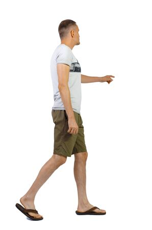 Back view of going pointing man in shorts. walking young guy . Rear view people collection. backside view of person. Isolated over white background. Stock Photo - 129826179