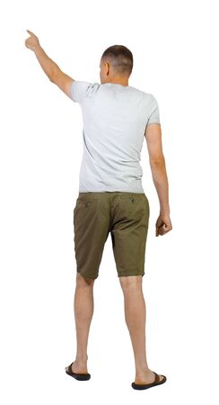 Back view of going handsome man in shorts pointing. walking young guy .backside view of person. Isolated over white background. Stock Photo - 129826205