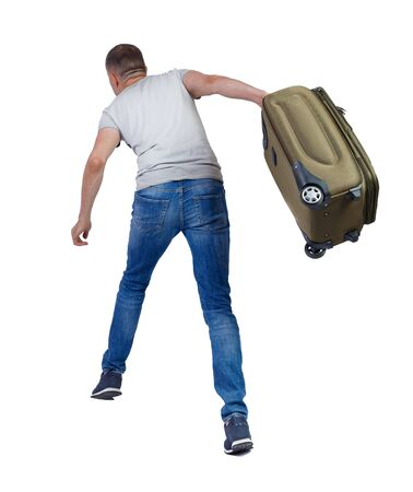 back view of walking man with suitcase. brunette guy in motion. backside view of person. Rear view people collection. Isolated over white background. The guy with the suitcase falls forward.