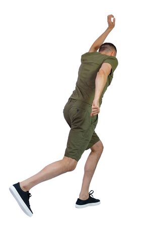 back view of running man in shorts. backside view of person. Rear view people collection. Isolated over white background. Jumping guy in shorts and sneakers.